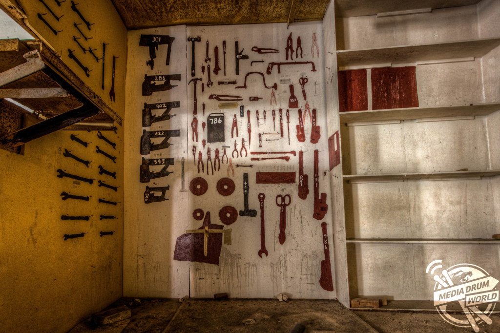 The inside of an abandoned tool room.