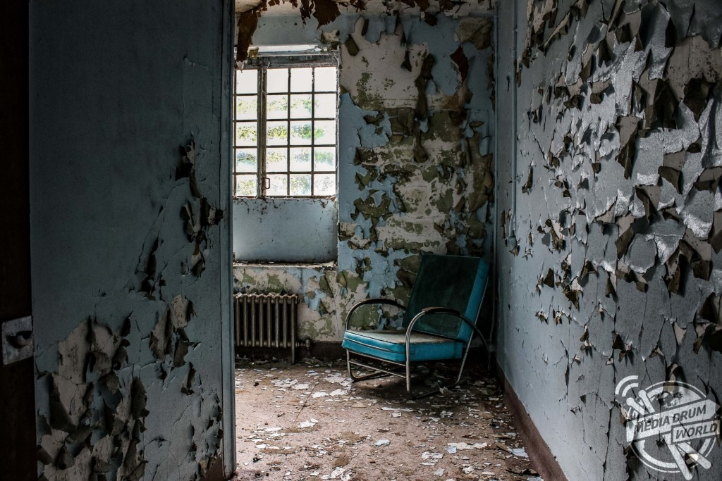 Peeling paint takes over the once fresh walls of the hospital.