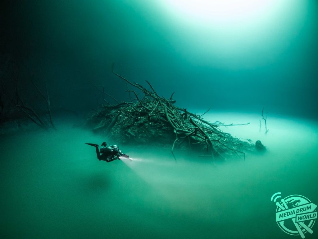 TULUM, MEXICO: A BRITISH diver has captured mind-bending pictures of what appears to be a lake floating inside water complete with its own ISLAND. The stunning snaps were taken at the Cenote Angelita sinkhole in Tulum, Mexico by British underwater photographer Tom St George (45) from London.