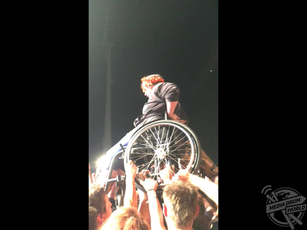 The woman crowd surfing in her wheelchair.
