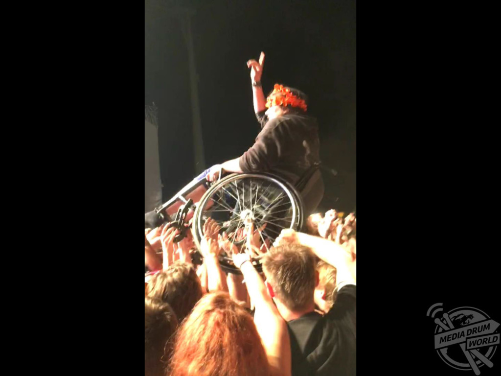 INCREDIBLE video footage has captured the moment a wheelchair-bound music lover surfed along the top of the crowd at a packed gig. The touching footage was taken by Amnesty International fundraiser Jacob Sanders (22), from Mitcham in Surrey, during a set by the band Disturbed as he attended the Novarock festival in Austria.