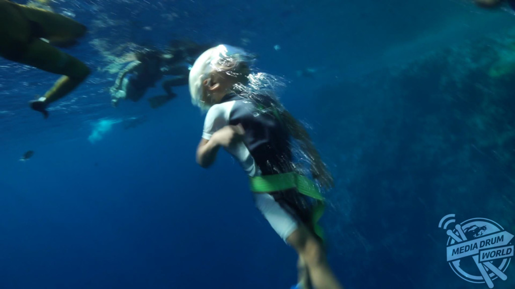 Fedor, aged three, using a rope to freedive.