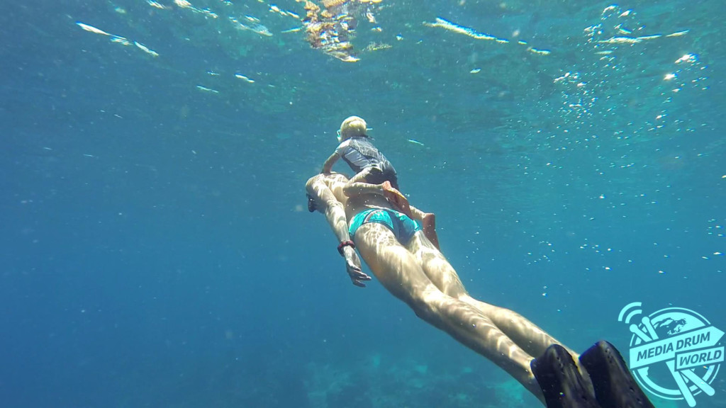 Fedor, aged two, freediving on his dad's back.