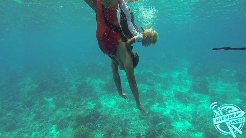 Fedor, aged two, freediving on his mum's back.