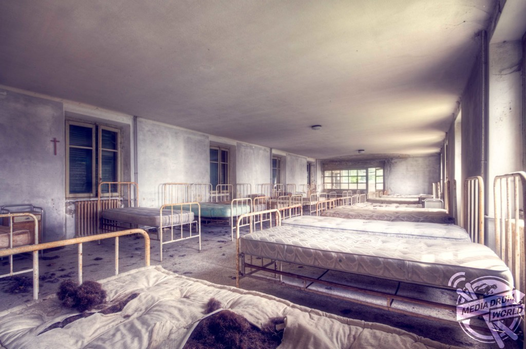 Beds inside an abandoned children's hospital in Italy. Roman Robroek / mediadrumworld.com
