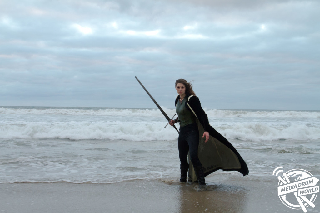 Samantha in the Pacific Surf with Longsword.