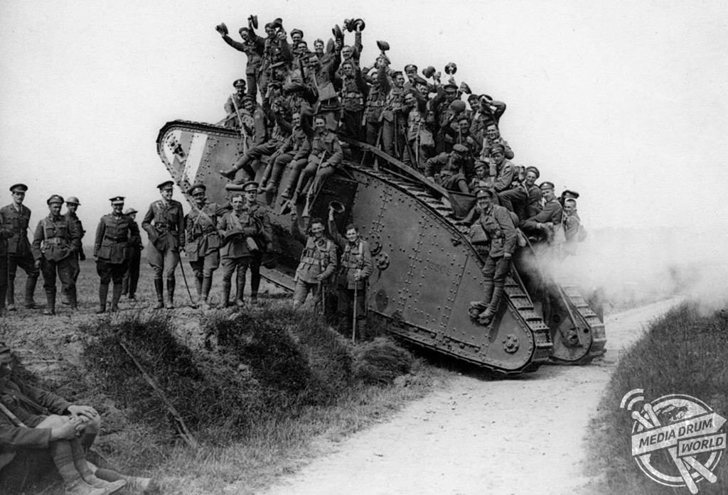 Jubilant British troops hitch a ride on a Mark IV after the massed tank fleet spearheading attack at Cambrai on 20 Nov 1917.  Anthony Tucker-Jones / mediadrumworld.com