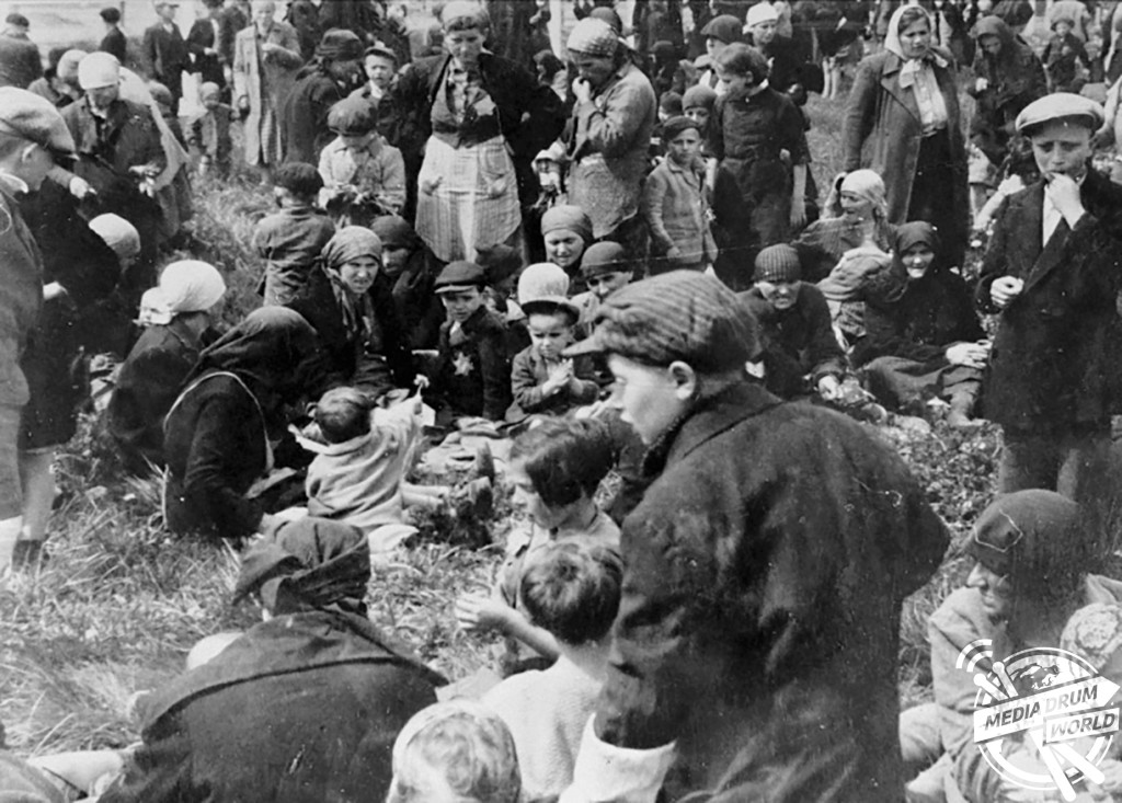 May 1944: Jews from Subcarpathian Rus wait in a clearing near a grove of birch trees before being led to the gas chambers.  Ian Baxter / mediadrumworld.com