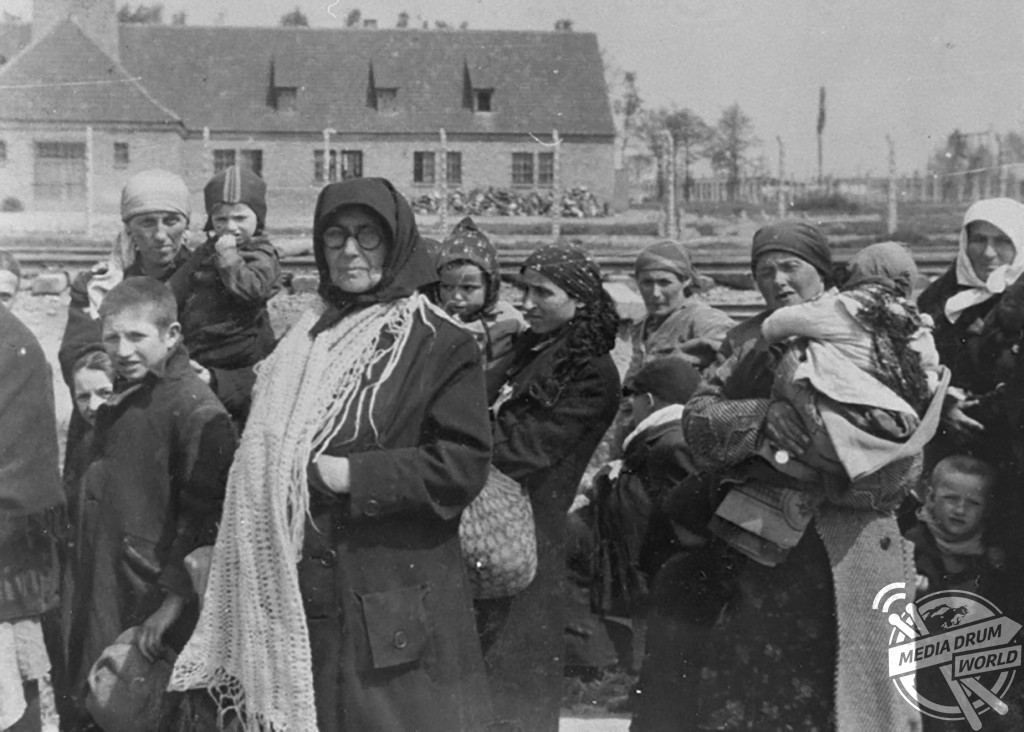 Jewish women and children walk toward the gas chambers. The building in the background is creamatorium III.  Ian Baxter / mediadrumworld.com