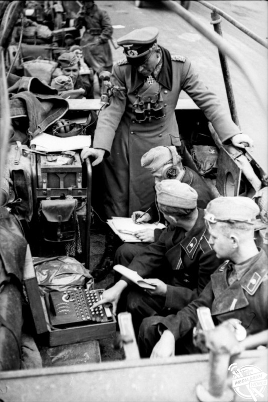 General Heinz Guderian in his command vehicle in 1940 during the battle for France with Enigma machine and three operators.  Joel Greenberg / mediadrumworld.com