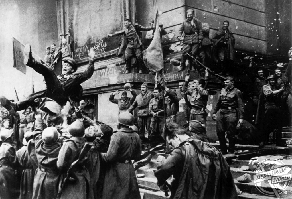 Celebrating the taking of the Reichstag.  Vassili J. Subbotin / mediadrumworld.com