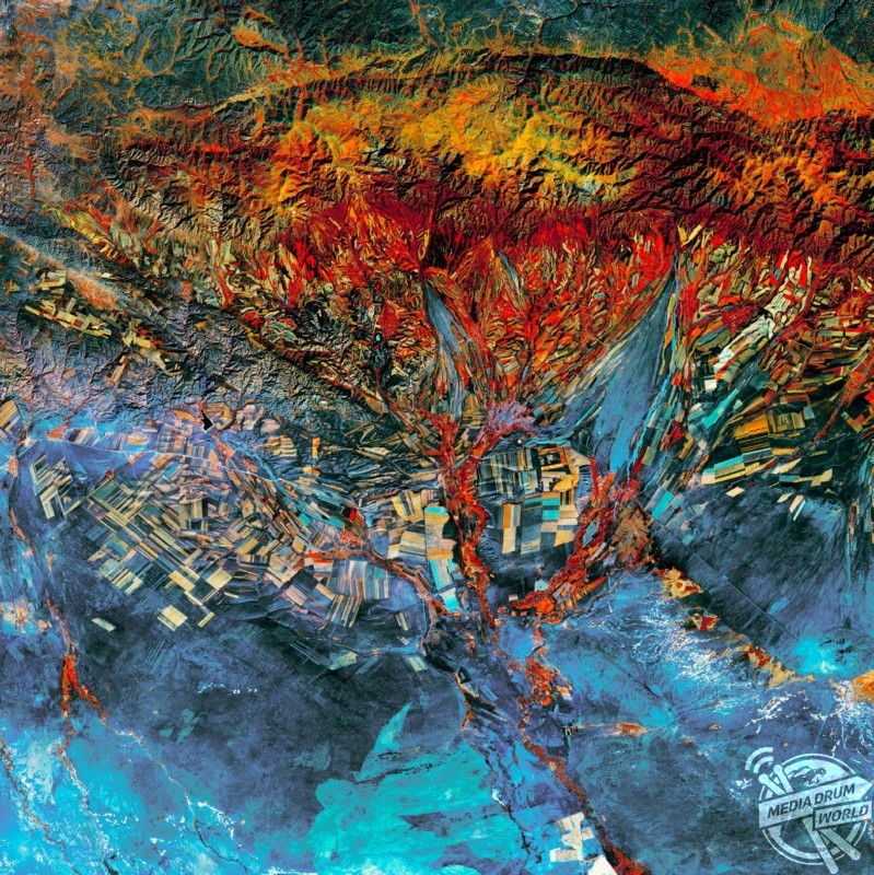 Agricultural landscape in Kazakhstan, satellite image. The fields in this area of eastern Kazakhstan follow the contours of the land. This results in long and narrow fields in mountain valleys, and large and rectangular fields on the plains. The differing crops and soils form a patchwork of colours.  US Geological Survey / SPL / mediadrumworld.com