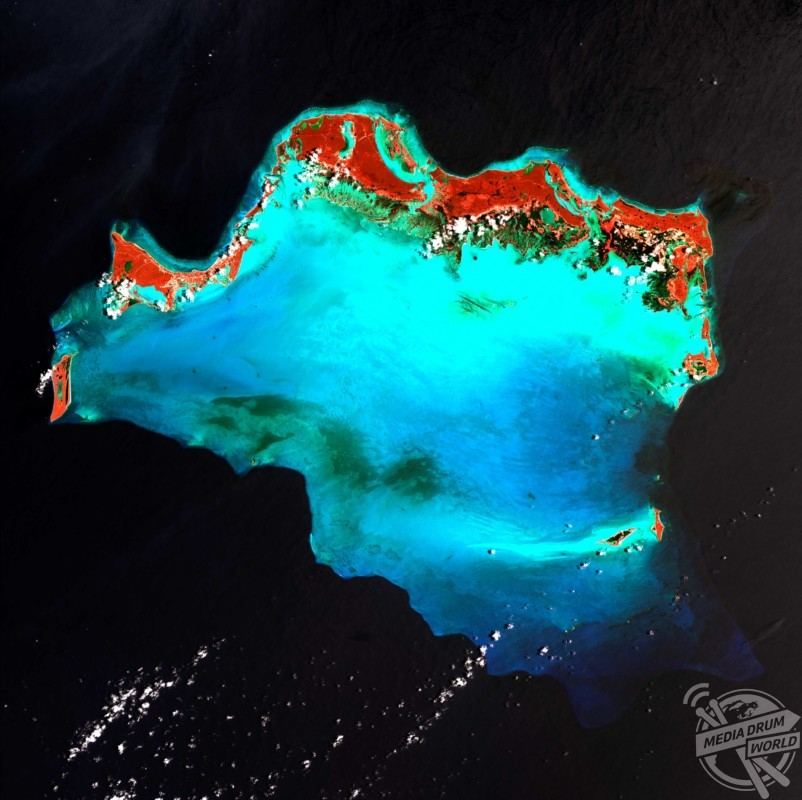Caicos Islands, satellite image. The Caicos Islands in the northern Caribbean are a popular tourist attraction, with beaches, luxury resorts and and clear waters for scuba diving. The islands lie along the northern perimeter of the submerged Caicos Bank (turquoise, centre), a shallow limestone platform formed of sand, algae, and coral reefs.  US Geological Survey / SPL / mediadrumworld.com